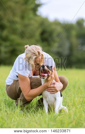 Woman Is Kissing Her Dog