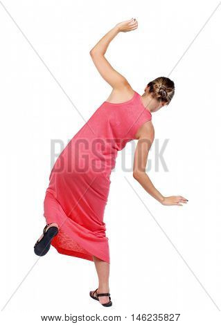Balancing young woman. or dodge falling woman. slender woman in a long red dress falls slipping.