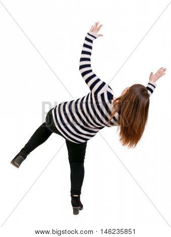 Balancing young woman. or dodge falling woman. Isolated over white background. Girl in a striped jacket falls falls dodging what the top.