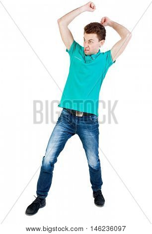 skinny guy funny fights waving his arms and legs. Isolated over white background. Funny guy clumsily boxing. Angry man with fists brasaetsya to someone else