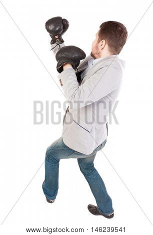 businessman with boxing gloves in fighting stance. Top view of a businessman in boxing gloves fighting.