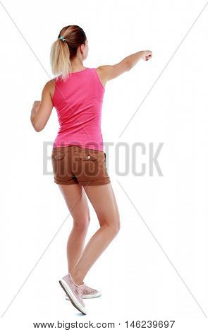 back view of woman funny fights waving his arms and legs. Isolated over white background. Sport blond in brown shorts fighting with their fists.