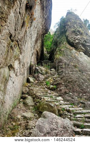 A stone stairwell leading up near a cliff in the Fangdong Scenic Area on Yandangshan mountains located in Zhejiang province China.