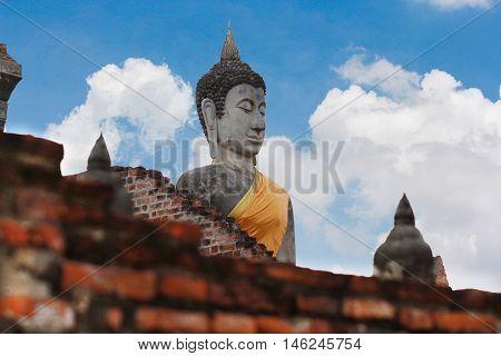 Buddha statue in Wat Yai Chai Mongkol on blue sky. Ayuttaya, Thailand