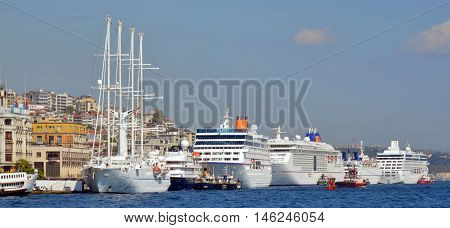 ISTANBUL,TURKEY OCTOBER 5: Cruise ferries in Eminonu Port near Yeni Cami and Galata Bridge on OCT 5, 2013 in Istanbul,Turkey. The Eminonu waterfront is a major dock for ferryboats in Istanbul.