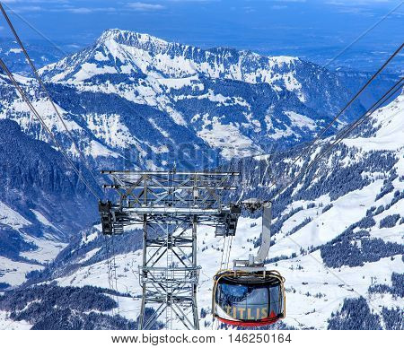 Mt. Titlis, Switzerland - 9 March, 2016: Rotair cable car gondola heading downwards, view from the station on the top of the mountain. Rotair gondolas make a 360 degrees turn during the five-minute trip.