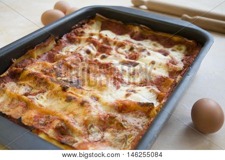 baking pan of lasagna seasoned with bolognese sauce