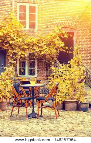 Cozy French Cafe terrace In Old Small European City