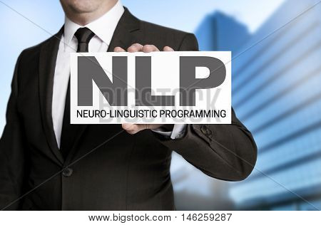 Nlp sign is held by businessman concept