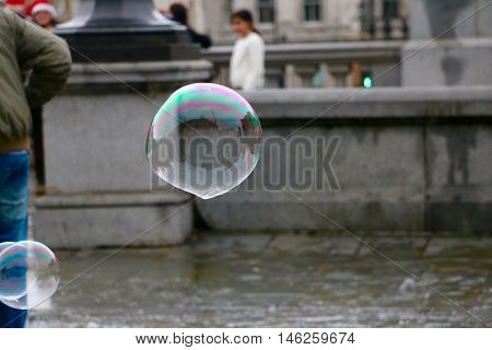 Big Bubble Reflecting a Background of a Buidling