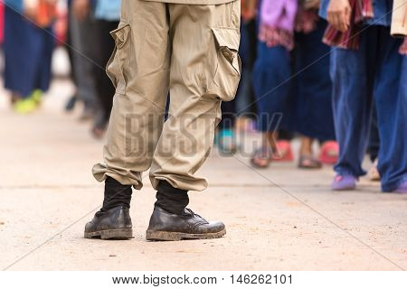 Leks of man in uniform suit in some festival in Thailand.