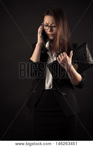 discontent teenager girl talking on mobile phone