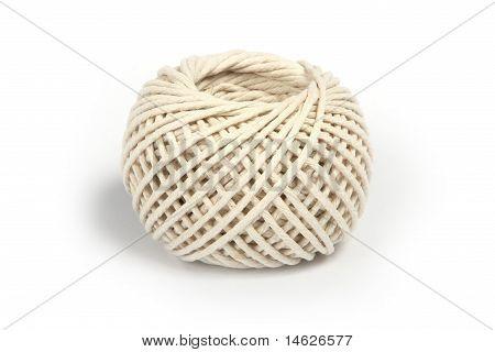 Ball of string, on white.