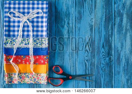 Cotton Fabrics For Sewing, Lace And Accessories For Needlework On Wooden Background.