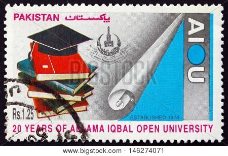 PAKISTAN - CIRCA 1995: a stamp printed in Pakistan shows Allama Iqbal Open University 20th Anniversary circa 1995
