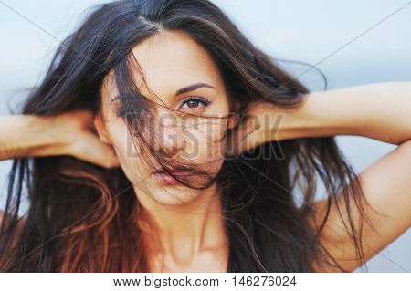 A Wonderful Portrait Of A Young Girl With Beautiful Brown Eyes, A Warm Summer Wind Swept Hair Gorgeo