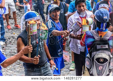 Antigua Guatemala - September 14 2015: Locals light torches before running in streets with them during Guatemalan Independence Day celebrations