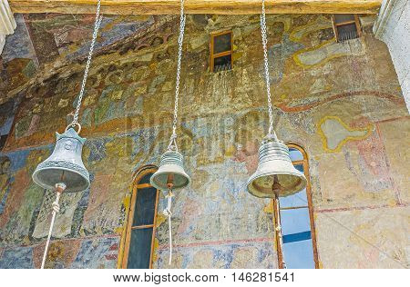 VARDZIA GEORGIA - MAY 27 2016: The bells of Dormition cave church with its facade wall covered by frescoes on May 27 in Vardzia.