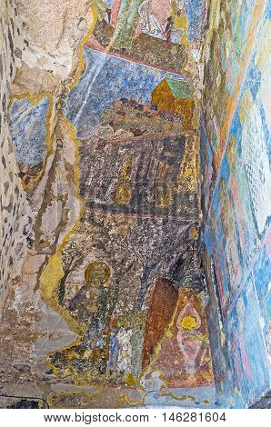 VARDZIA GEORGIA - MAY 27 2016: The narrow cave at the entrance to Dormition church covered by old murals on May 27 in Vardzia.