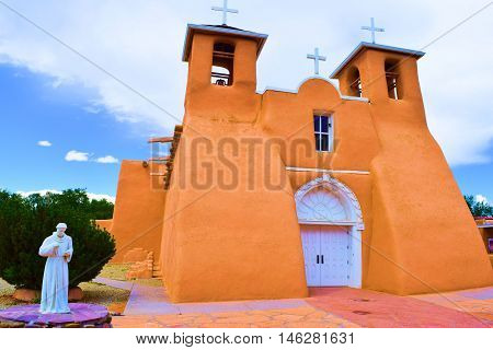 San Francisco de Asis Mission Church completed in 1816 which is a historic adobe Spanish colonial style cathedral taken in Taos, NM
