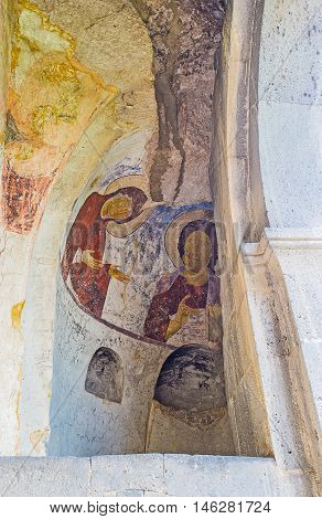 VARDZIA GEORGIA - MAY 27 2016: The semi-dome at the entrance to Dormition Church is covered with old fresco depicting Mother of God and Jesus Christ on May 27 in Vardzia.