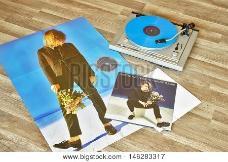 VILNIUS, LITHUANIA - 2015: Christine and the Queens vinyl record Chaleur humaine album, record player with a vinyl on a wooden floor.