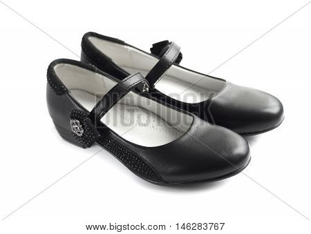 Pair of black shoes for girl on white background