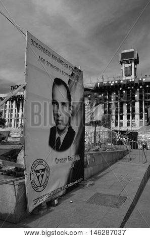 Stephan Bandera poster (Ukrainian nationalist icon ) near Burnt down the House of trade unions.Riot in Kiev.March 24, 2014 Kiev, Ukraine