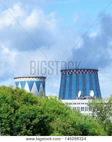 Towers of CHP in the city. Central Heating and Power Plant.