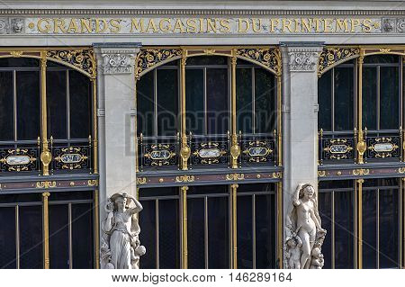 PARIS FRANCE - OCTOBER 11 2015: Part of facade from store Printemps (founded in 1865) in Paris - largest beauty Department Store in world with 45000 square meters of shopping.