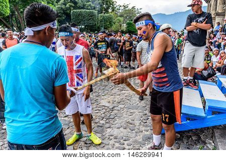 Antigua Guatemala - September 14 2015: Runners light torches while blowing whistles outside city hall during Guatemalan Independence Day celebrations