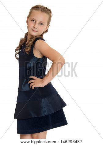 Nice little girl in a fashionable dress. Girl posing turned sideways to the camera. Close-up - Isolated on white background