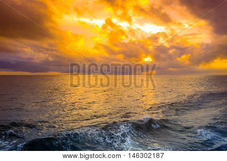 Out in the middle of the sea at sunrise.