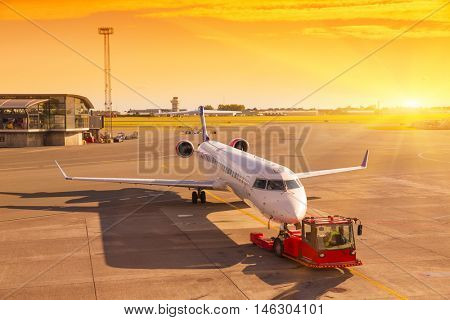 Copenhagen - August 17.2016: Planes preparing for take off at Copenhagen Airport. Airplane at sunrise in the terminal gate ready for takeoff - Waiting for the flight. Travel around the world