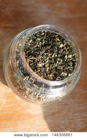 Tea leaves for brew with hot water in clear bottle
