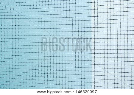 Silhouette of Structure mesh metal fence on cement wall background