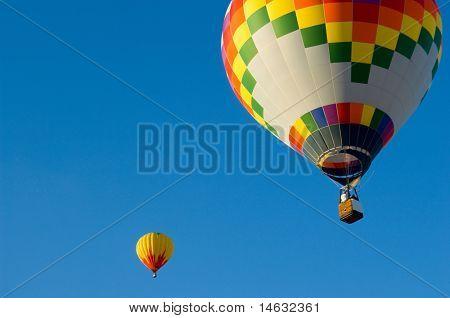 Beautiful hot air balloon against dark blue sky with basket