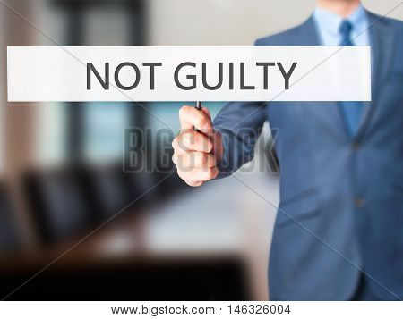 Not Guilty - Business Man Showing Sign