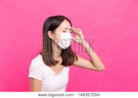 Woman wearing face mask and feeling unwell