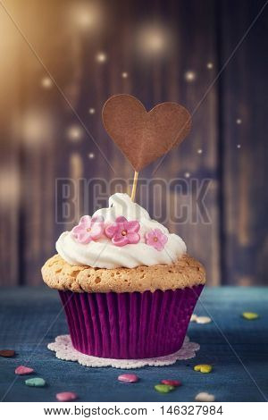 Cupcake with a heart cakepick