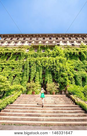 Old green building covered with ivy in Milan city