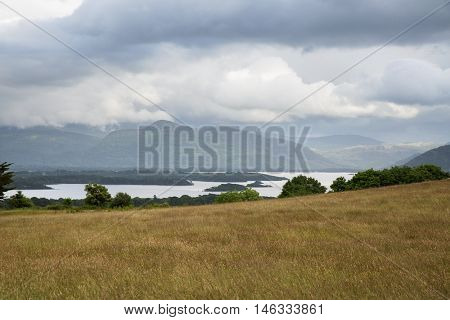 nature and landscape concept - view to plain with lake or river valley and hills at connemara in ireland
