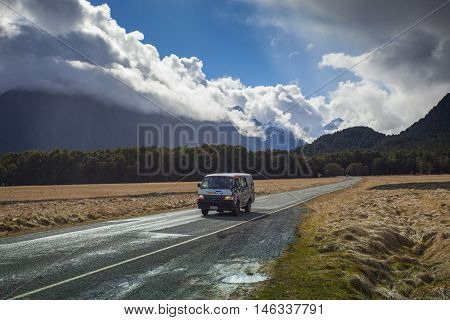 MILFORD SOUND NEW ZEALAND-AUGUST 30 : camper van on the road to milford sound fiord land national park important destination to traveling on august30 2015 in Milford SoundNew Zealand