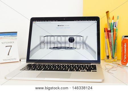 PARIS FRANCE - SEP 8 2016: Apple Computers website on MacBook Pro Retina in a geek creative room environment showcasing new Apple Watch Series 2 Ceramic Edition