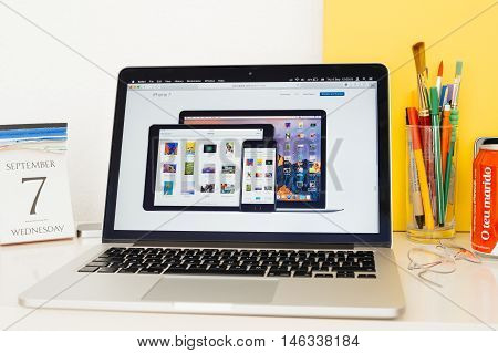 PARIS FRANCE - SEP 8 2016: Apple Computers website on MacBook Pro Retina in a geek creative room environment showcasing iPad Pro iPhone 7 and MAc Book Air with ios 10