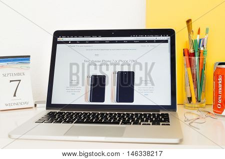 PARIS FRANCE - SEP 8 2016: Apple Computers website on MacBook Pro Retina in a geek creative room envir compare iPhone 7 vs iPhone 7 plusonment showcasing