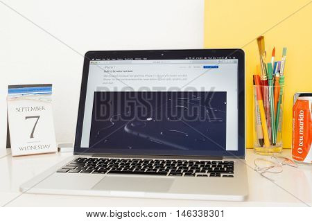 PARIS FRANCE - SEP 8 2016: Apple Computers website on MacBook Pro Retina in a geek creative room environment showcasing the water resistant IP76 iPhone 7 smartphone