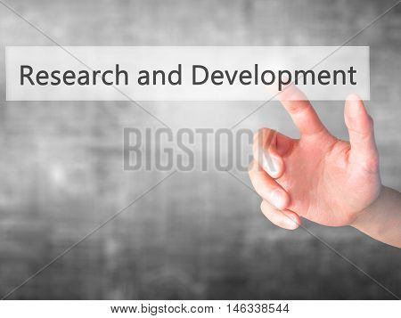 Research And Development - Hand Pressing A Button On Blurred Background Concept On Visual Screen.