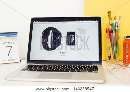 PARIS FRANCE - SEP 8 2016: Apple Computers website on MacBook Pro Retina in a geek creative room environment showcasing new Apple Watch Series 2 range