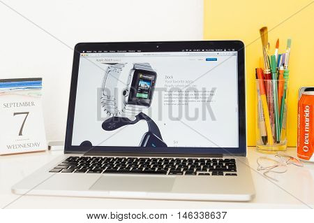 PARIS FRANCE - SEP 8 2016: Apple Computers website on MacBook Pro Retina in a geek creative room environment showcasing new Apple Watch Series 2 Dock for favorite apps
